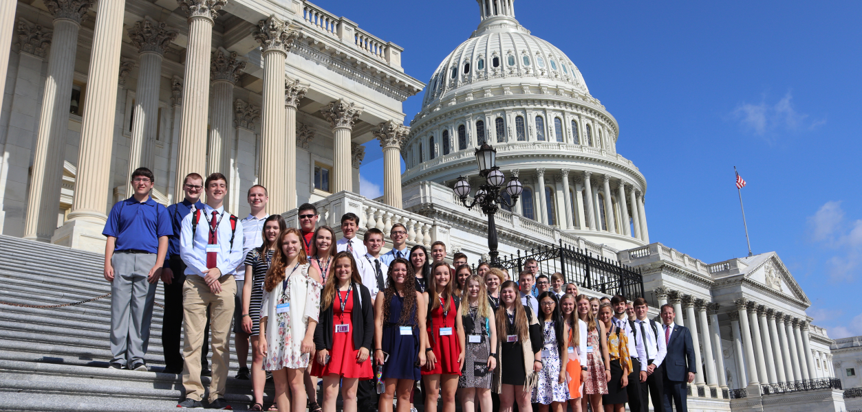 Tour group on the steps of the Capitol building